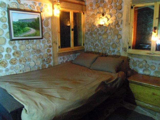 Futon, opened to double bed, has premium mattress.