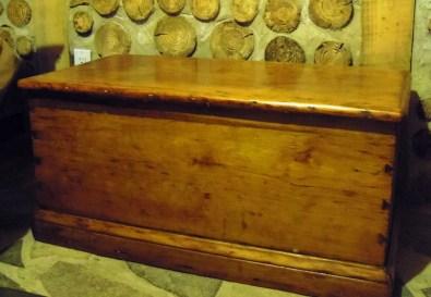 Antique 6 board chest: daytime storage for bedding.