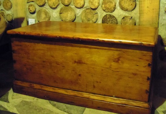 Antique 6 board chest: daytime storage for bedding.