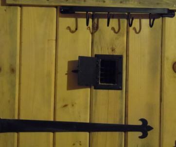 Detail of door speakeasy: Hark, who goes there?!