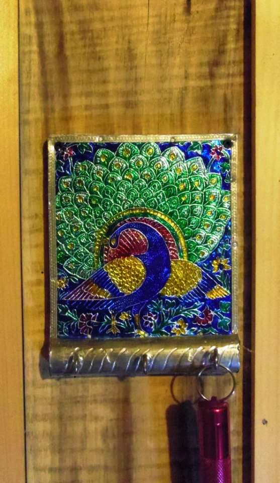 Detail of key hooks: You are staying in Peacock Forest.