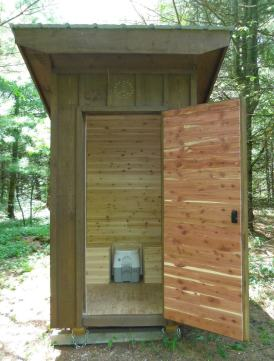 Privy door is lined with aromatic red cedar.