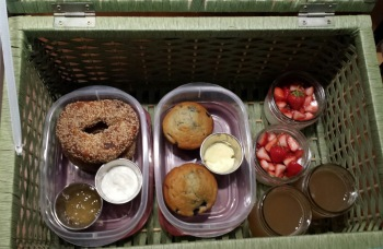 Bagels, muffins, yogurt & local strawberries, apple cider.